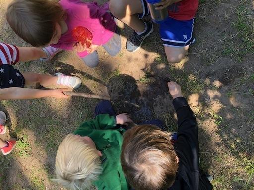 Children with mud.jpg